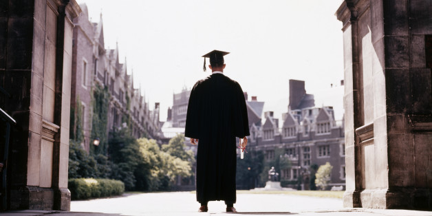 1960s BACK VIEW MALE GRADUATE WEARING CAP AND GOWN STANDING IN CAMPUS ARCHWAY UNIVERSITY OF PENNSYLVANIA PHILADELPHIA USA  (Photo by H. Armstrong Roberts/ClassicStock/Getty Images)