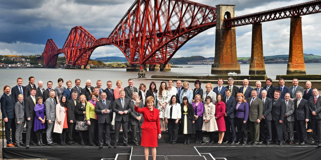 EDINBURGH, SCOTLAND - MAY 09:  First Minister and leader of the SNP Nicola Sturgeon is joined by the newly elected members of parliament as they gather in front of the Forth Rail Bridge on May 9, 2015 in South Queensferry, Scotland. Back (L-R) Stuart McDonald, Callum McCaig, Patrick Grady, Stewart McDonald, Allison Thewliss, Stuart Donaldson, Ronnie Cowan, Paul Monaghan, Pete Wishart, Brendan O'Hara, Hannah Bardell, John Nicolson, Michelle Thomson, Natalie McGarry, Tasmina Ahmed-Sheikh, Eilidh W