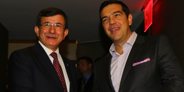 NEW YORK, USA - SEPTEMBER 29: Turkish Prime Minister Ahmet Davutoglu (L) and Greek Prime Minister Alexis Tsipras (R) hold a meeting in New York, USA on September 29, 2015. (Photo by Hakan Goktepe/Anadolu Agency/Getty Images)