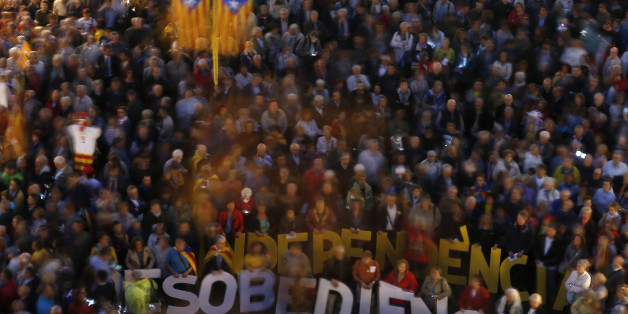 "People hold words meaning ""Independence and Disobedience"" during a rally in Barcelona, Spain, Tuesday, Oct. 13, 2015. Thousands of pro-Catalan independence supporters are protesting the opening of a court investigation into the regional government's staging of a symbolic referendum on secession from Spain last year. (AP Photo/Manu Fernandez)"