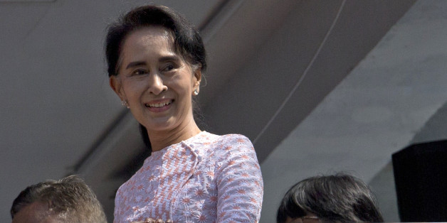 Myanmar's opposition leader Aung San Suu Kyi smiles after delivering a speech in Yangon, Myanmar, Monday, Nov. 9, 2015. Suu Kyi on Monday hinted that her party will win the country's historic elections, and urged supporters not to provoke their losing rivals. (AP Photo/Gemunu Amarasinghe)