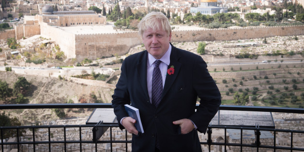 Mayor of London Boris Johnson looks out over the Old City of Jerusalem from the Mount of Olives today during a tour of the historic town where he also prayed at the Western Wall, on the third day of his trade visit to Israel.