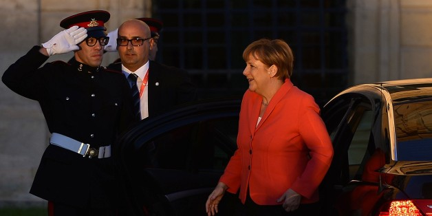 Germany's Chancellor Angela Merkel arrives at the Auberge de Castille in La Valletta on November 11, 2015 for the European Union - Africa Summit on Migration to cope with the biggest flow of refugees and migrants since World War II. EU leaders will meet their African counterparts in Malta today with pledges of billions of euros in aid in exchange for help in reducing migration to an overwhelmed Europe. The Europeans aim to ask African heads of state and government in Valletta to take back more economic migrants in return for up to 3.6 billion euros ($2 billion) to tackle root causes of migration like poverty and armed conflict.  AFP PHOTO / FILIPPO MONTEFORTE        (Photo credit should read FILIPPO MONTEFORTE/AFP/Getty Images)