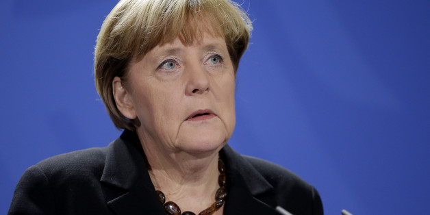 German Chancellor Angela Merkel speaks during a statement on the death of former German Chancellor Helmut Schmidt in Berlin, Germany, Tuesday, Nov. 10, 2015. Schmidt died today in the age of 96 years. (AP Photo/Michael Sohn)