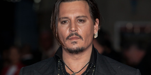 Actor Johnny Depp poses for photographers upon arrival at the Premiere of the film Black Mass, showing as part of the London Film Festival, in central London, Sunday, Oct. 11, 2015. (Photo by Grant Pollard/Invision/AP)