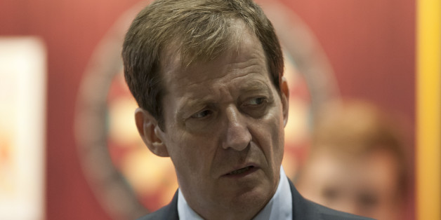 Alastair Campbell, former Director of Communications and Strategy for ex Prime Minister Tony Blair, is seen by the conference hall on the first day of Britain's Conservative Party Conference, Manchester, England, Sunday, Sept. 29, 2013. (AP Photo/Jon Super)