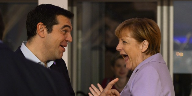 Germany's Chancellor Angela Merkel (R) talks to Greece's Prime minister Alexis Tsipras as she arrives for a second working session of the European Union - Africa Summit on Migration at the Meditterranean Conference Center, on November 12, 2015 in La Valletta.EU leaders attending a summit with their African counterparts today approved a 1.8-billion-euro trust fund for Africa aimed at tackling the root causes of mass migration to Europe. AFP PHOTO / FILIPPO MONTEFORTE        (Photo credit should read FILIPPO MONTEFORTE/AFP/Getty Images)