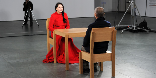 NEW YORK - MARCH 09:  Artist Marina Abramovic (in red) performs during the 'Marina Abramovic: The Artist is Present' exhibition opening night party at The Museum of Modern Art on March 9, 2010 in New York City.  (Photo by Andrew H. Walker/Getty Images)