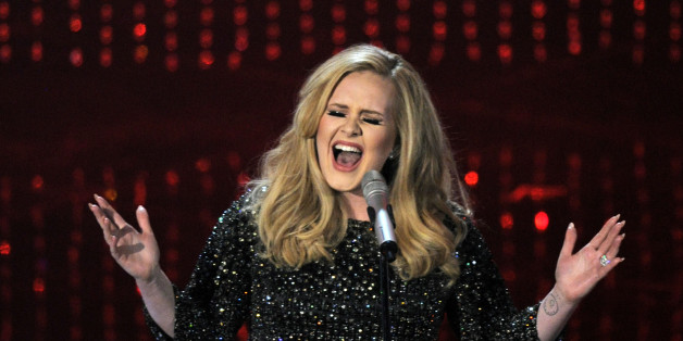 """FILE - In this Feb. 24, 2013 file photo, Adele performs during the Oscars at the Dolby Theatre in Los Angeles. Adele's """"Hello"""" single has become the first song to sell one million tracks in a week. Her comeback track sold 1.11 million digital songs, setting a new record. Her complete album """"25,"""" will be released on Nov. 20. (Photo by Chris Pizzello/Invision/AP, File)"""