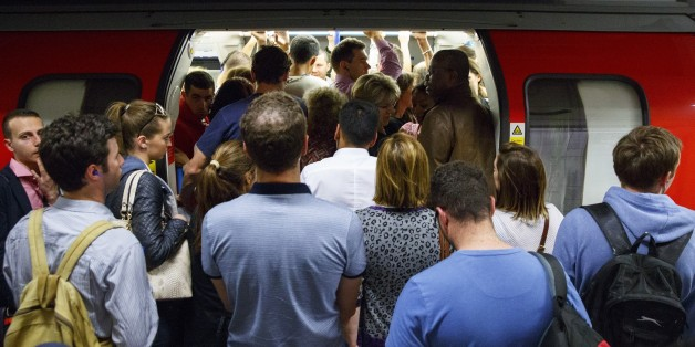 LONDON, UNITED KINGDOM - JULY 08: Commuters queuing for tube trains at Green Park Tube Station ahead of the tube strike in evening rush hour of July 8, 2015 in London, England. The strike will be a 27-hour stoppage by about 20,000 Tube staff to shut down the entire London Underground network. (Photo by Tolga Akmen/Anadolu Agency/Getty Images)