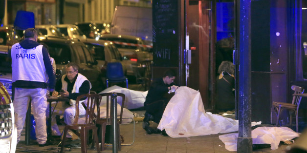 RETRANSMISSION FOR ALTERNATIVE CROP - Victims lay on the pavement outside a Paris restaurant, Friday, Nov. 13, 2015.  Police officials in France on Friday report multiple terror incidents, leaving many dead.  It was unclear at this stage if the events are linked. (AP Photo/Thibault Camus)