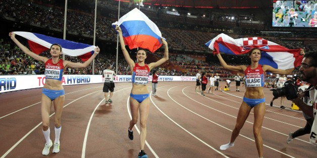 Russia's Maria Kuchina, center, Croatia's Blanka Vlasic, right, and Russia's Anna Chicherova celebrate after the women's high jump final at the World Athletics Championships at the Bird's Nest stadium in Beijing, Saturday, Aug. 29, 2015. Kuchina won the event, Vlasic took second place and Chicherova placed third.  (AP Photo/Andy Wong)