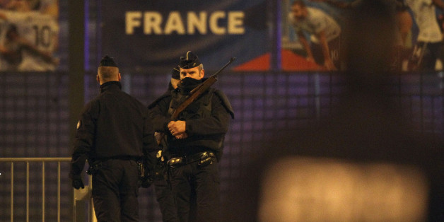 Police officers stand guard outside the Stade de France stadium after an explosion and after international friendly soccer match France against Germany, in Saint Denis, outside Paris, early Saturday Nov. 14, 2015. Multiple fatal attacks throughout the city have prompted President Francois Hollande to announce he was closing the country's borders and declaring a state of emergency. (AP Photo/Michel Spingler)