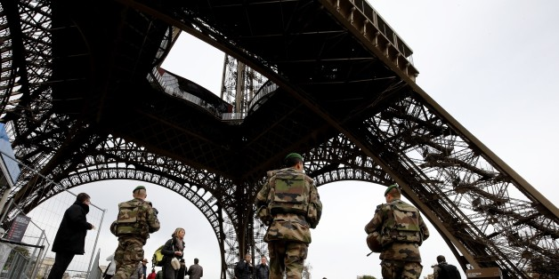 French soldiers patrol the area at the foot of the Eiffel Tower in Paris on November 14, 2015 following a series of coordinated attacks in and around Paris late Friday which left more than 120 people dead.    French President Francois Hollande blamed the Islamic State group for the attacks in Paris that left at least 128 dead, calling them an 'act of war'. The multiple attacks across the city late Friday were 'an act of war... committed by a terrorist army, the Islamic State, against France, against... what we are, a free country,' Hollande said. AFP PHOTO / FRANCOIS GUILLOT        (Photo credit should read FRANCOIS GUILLOT/AFP/Getty Images)