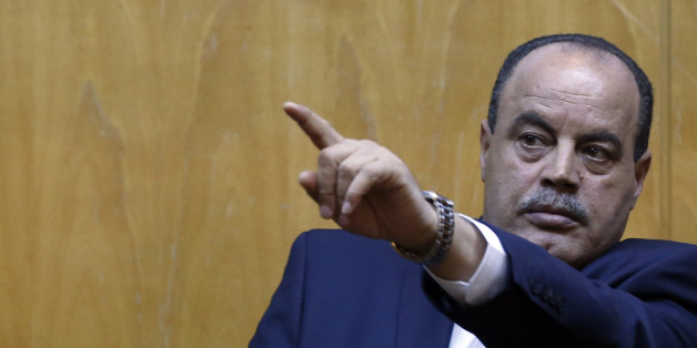 CORRECTING NAME OF TUNISIAN INTERIOR MINISTER TO MOHAMED NAJEM GHARSALLI - Tunisian Interior Minister Mohamed Najem Gharsalli gestures during a press conference in Imperial Marhaba hotel in Sousse, Tunisia, Monday, June 29, 2015, the scene of Friday's beach massacre. The top security officials of Britain, France, Germany and Belgium are paying homage to the people killed in the beach terrorist attack on Friday. (AP Photo/Darko Vojinovic)