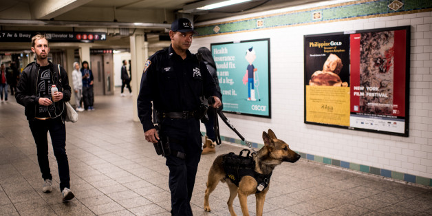 NEW YORK, NY - NOVEMBER 14: A police officer patrols the Times Square subway stop with his dog following a series of terrorist attacks in Paris on November 14, 2015 in New York City. Security in New York City has increased following the coordinated assault on Paris which ISIS claimed responsibility for. At least 120 people have been killed and over 200 injured, 80 of which seriously.  (Photo by Andrew Renneisen/Getty Images)
