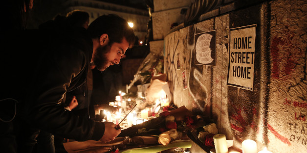 Mourners light candles at a Place de la République in Paris, France on Saturday, Nov. 14, 2015. French President Francois Hollande blamed Islamic State militants for coordinated strikes in Paris that left 127 dead, bringing the conflict with the radical group to the heart of the Western world. Photographer: Simon Dawson/Bloomberg via Getty Images