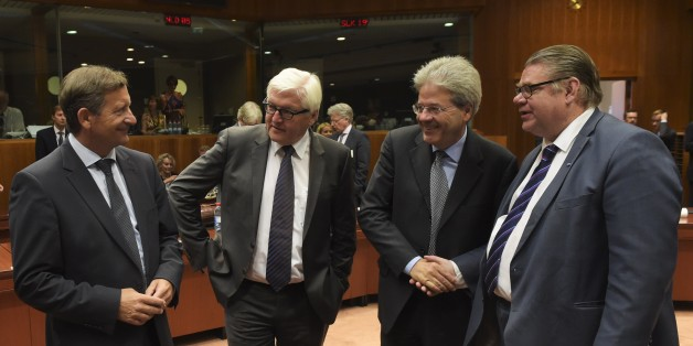 (L-R) Slovenia Foreign minister Karl Erjavec, German Foreign Minister Frank-Walter Steinmeier, Italian Foreign Affairs Minister Paolo Gentiloni and Finnish Foreign Minister Timo Soini talk with one another during a Foreign Affairs meeting at the European Union headquarters in Brussels on July 20, 2015. European foreign ministers meet to discuss the Iran nuclear deal, unrest in Libya and Tunisia and the deadlocked Middle East peace process. AFP PHOTO/JOHN THYS        (Photo credit should read JOH