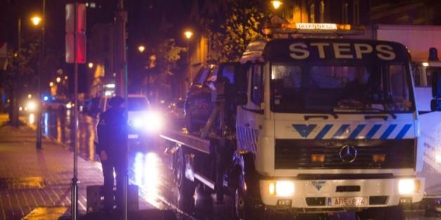 Un raid de la police belge dans le quartier de Molenbeek à Bruxelles, en lien avec les attentats de Paris le 14 novembre 2015