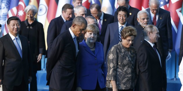 ANTALYA, TURKEY - NOVEMBER 15:  (Front row L-R) Chinese President Xi Jinping, US President Barack Obama, German Chancellor Angela Merkel, Brazilian President Dilma Rousseff and Russian President Vladimir Putin arrive for a family photo during the G20 Turkey Leaders Summit on November 15, 2015 in Antalya, Turkey. (Photo by Aykut Unlupinar/Anadolu Agency/Getty Images)