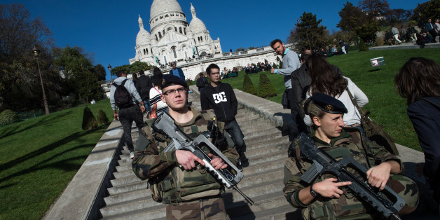 PARIS, FRANCE - NOVEMBER 15:  French soldiers stand guard at the 'Sacre-Coeur' cathedral on November 15, 2015 in Paris, France. As France observes three days of national mourning members of the public continue to pay tribute to the victims of Friday's deadly attacks. A special service for the families of the victims and survivors is to be held at Paris's Notre Dame Cathedral later on Sunday.  (Photo by David Ramos/Getty Images)