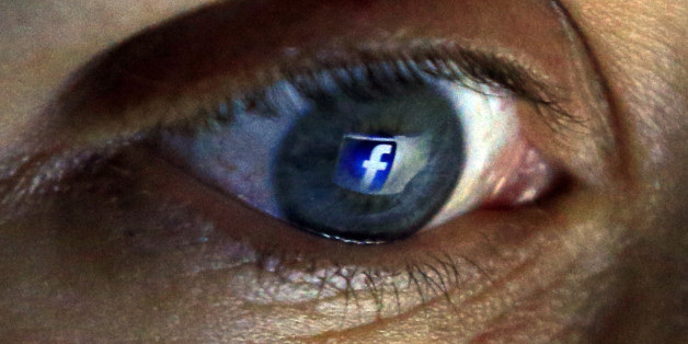 PICTURE POSED BY MODEL File photo dated 27/08/15 of the Facebook logo seen reflected in a person's eye, as the social network's revenues have jumped to 4.5 billion dollars (£2.92 billion) as its number of global users grew to a record 1.55 billion.