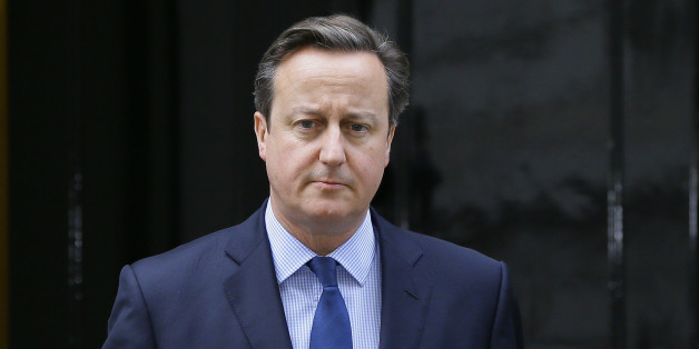 "Britain's Prime Minister David Cameron arrives to make a statement about the death of Islamic State militant Mohammed Emwazi, known as ""Jihadi John"", at Downing Street in London, Friday, Nov. 13, 2015.  A U.S. drone strike targeted a vehicle in Syria believed to be transporting the masked Islamic State militant known as ""Jihadi John"" on Thursday, Nov. 12, according to American officials, but his death is not yet confirmed. (AP Photo/Kirsty Wigglesworth)"