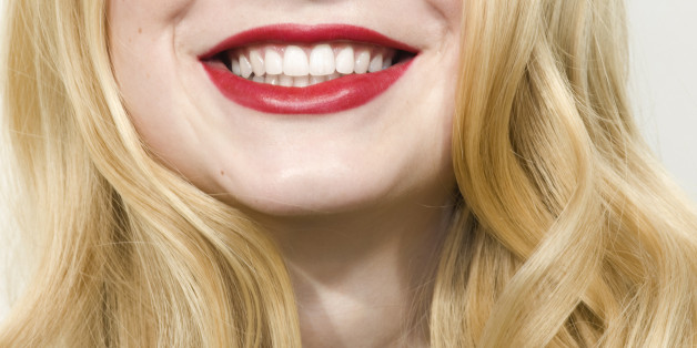 Young woman smiling, red lips, close up