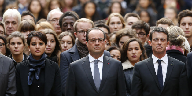 French President Francois Hollande, center, flanked by French Prime Minister Manuel Valls, right, and French Education Minister Najat Vallaud-Belkacem, center left, stands among students during a minute of silence in the courtyard of the Sorbonne University in Paris, Monday, Nov. 16 2015. A minute of silence was observed throughout the country in memory of the victims of last Friday's attack. (Guillaume Horcajuelo, Pool via AP)