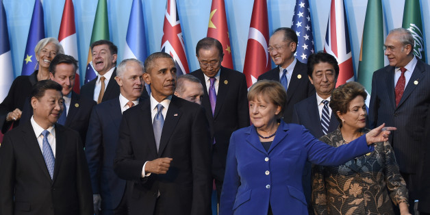 President Barack Obama, center, walks with Germany's Chancellor Angela Merkel, in blue, and other leaders as they try to figure out which way to go following the G20 Summit group photo in Antalya, Turkey, Sunday, Nov. 15, 2015. Obama is attending the G20 Summit while on a nine-day foreign trip that also includes stops in the Philippines and Malaysia for other global security and economic summits. (AP Photo/Susan Walsh)