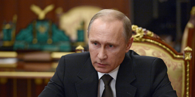 Russian President Vladimir Putin heads a meeting on Russian plane crash in Egypt in Moscow's Kremlin, Russia, early Tuesday, Nov. 17, 2015. The head of Russia's FSB security service says the crash of the passenger plane in Egypt was the result of a 'terrorist' act. Alexander Bortnikov told Putin on Tuesday that a homemade explosive device blew up on the plane. All 224 people on board the plane, most of them Russian tourists, were killed in the Oct. 31 crash. (Alexei Nikolsky/SPUTNIK, Kremlin Poo