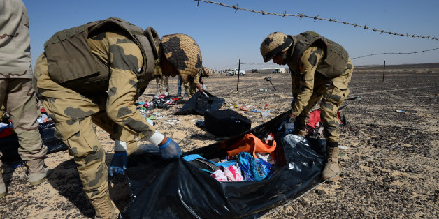 """FILE - In this file Russian Emergency Situations Ministry photo, made available on Monday, Nov. 2, 2015 Egyptian soldiers collect personal belongings of plane crash victims at the crash site of a passenger plane bound for St. Petersburg in Russia that crashed in Hassana, Egypt's Sinai Peninsula. The Russian passenger plane that crashed in Egypt was brought down by a homemade bomb placed on board in a """"terrorist"""" act, the head of Russia's FSB security service told President Vladimir Putin on Tues"""