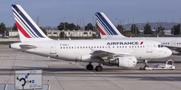 Air France passenger aircraft, operated by Air France-KLM Group, sit on the tarmac at Charles De Gaulle airport, operated by Aeroports de Paris, in Roissy, France, on Thursday, Oct. 8, 2015. Air France will bring in an aide to French Prime Minister Manuel Valls as human resources chief after the incumbent became embroiled in a tussle with protesters who ripped off his shirt at a briefing on job cuts. Photographer: Christophe Morin/Bloomberg via Getty Images