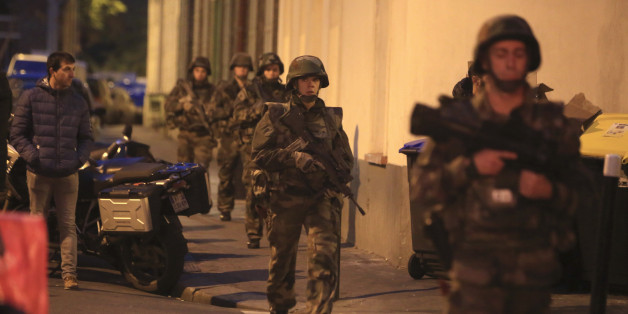 French soldiers patrol in Paris suburb Saint Denis, Wednesday, Nov.18, 2015.  Authorities are telling residents to stay inside during a large police operation near France's national stadium that two officials say is linked to last week's deadly attacks. (AP Photo/Thibault Camus)