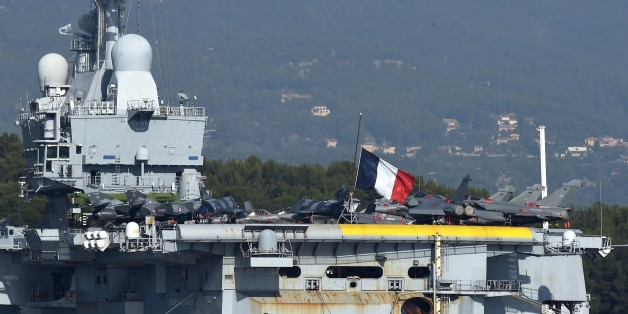 Charles de Gaulle, the flagship of the French Navy and the largest western European warship currently in commission, is seen anchored in the military port of Toulon, on November 17, 2015, before leaving on mission in Mediterranean Sea to take part in operations on Syria.  AFP PHOTO / ANNE-CHRISTINE POUJOULAT        (Photo credit should read ANNE-CHRISTINE POUJOULAT/AFP/Getty Images)