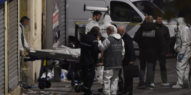 A second body is removed from the apartment raided by French Police special forces earlier in the northern Paris suburb of Saint-Denis, on November 18, 2015, hunting those behind the attacks that claimed 129 lives in the French capital five days ago. French police said the assault had concluded on an apartment in northern Paris in which at least two jihadists were killed and seven arrested. AFP PHOTO / ERIC FEFERBERG        (Photo credit should read ERIC FEFERBERG/AFP/Getty Images)