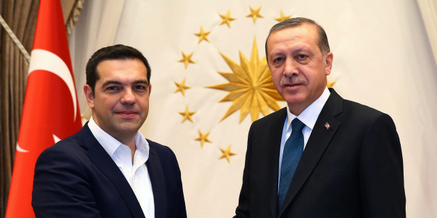 """Greece's Prime Minister Alexis Tsipras, left, and Turkish President Recep Tayyip Erdogan shake hands before a meeting in Ankara, Turkey, Wednesday, Nov. 18, 2015. Turkey and Greece have agreed to cooperate to prevent the """"human tragedy"""" suffered by thousands of migrants who risk lives crossing the Aegean Sea on their way to Europe. Davutoglu and Tsipras said however, that the refugee burden cannot be placed on the two countries' shoulders alone, insisting that other European nations share the responsibility.(Presidential Press Service/Pool Photo via AP)"""
