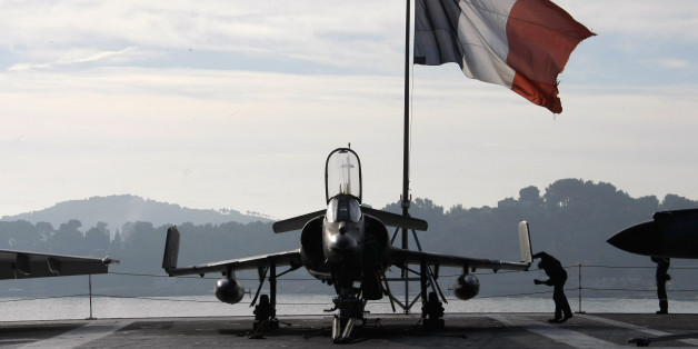 A French sailor checks a Super-Etendard jetflighter on the deck of France's nuclear-powered aircraft carrier Charles de Gaulle before to leave its home port of Toulon, southern France, Wednesday, Nov.18, 2015. France has decided to deploy its aircraft carrier in the eastern Mediterranean sea for fighting Islamic State group.(AP Photo/Claude Paris)