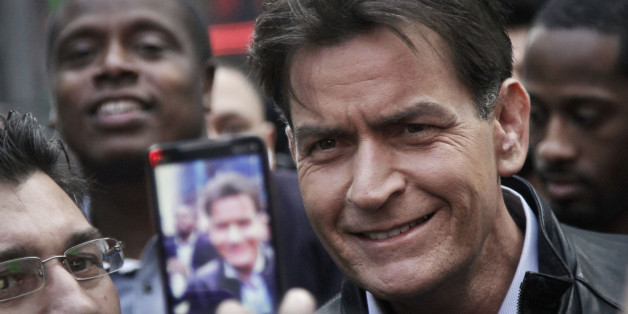 "FILE - In this Monday, Jan. 14, 2013, file photo, actor Charlie Sheen is mobbed for autographs and photos as he makes his way through Times Square in New York. In an interview Tuesday, Nov. 17, 2015, on NBC's ""Today,"" Sheen said he tested positive for the virus that causes AIDS. (AP Photo/Bebeto Matthews, File)"