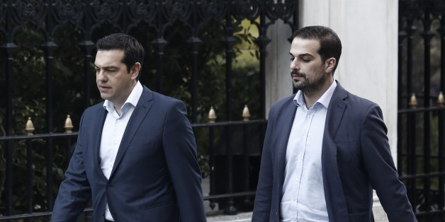 Alexis Tsipras, Greece's prime minister, left, and government spokesman Gabriel Sakelaridis, walk to Maximos mansion  in Athens, Greece, on Monday, July 6, 2015. Euclid Tsakalotos was named finance minister to replace Yanis Varoufakis, who resigned Monday after more than five months of fruitless back and forth. Photographer: Kostas Tsironis/Bloomberg via Getty Images