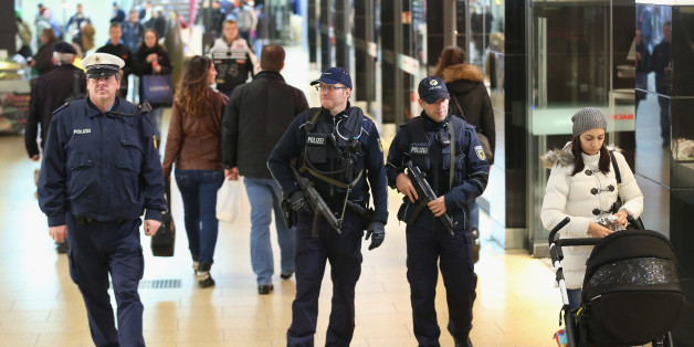 HANOVER, GERMANY - NOVEMBER 18:  Heavily-armed German policemen patrol through a shopping passage inside Hauptbahnhof main railway station the day after the Germany vs. Netherlands friendly football match was cancelled due to a terror warning on November 18, 2015 in Hanover, Germany. German authorities cancelled the game two hours before it was due to start following what the German Minister of Interior said were concrete warnings from a foreign intelligence service that an attack was imminent. Investigators however found no explosives and made no arrests.  (Photo by Sean Gallup/Getty Images)