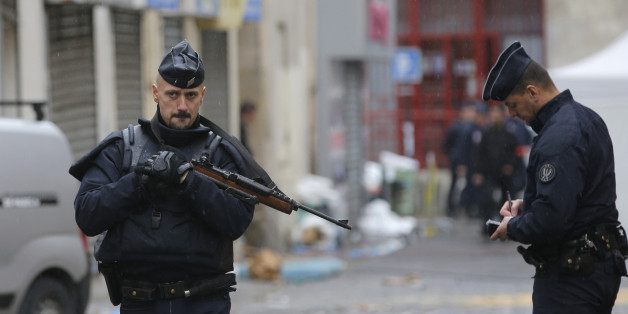 Police officers guard the street of Wednesday's raid on an apartment in Paris suburb Saint-Denis, Thursday Nov.19, 2015. With France still reeling from last week's deadly attacks in Paris, Prime Minister Manuel Valls warned Thursday that Islamic extremists might at some point use chemical or biological weapons, and urged lawmakers to extend a national state of emergency by three months. (AP Photo/Christophe Ena)