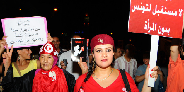 "In this  Monday, Aug. 13, 2012 photo Tunisian women carry placards protesting their rights which read: ""no future for Tunisia without women"" and right, ""equal rights for men and women"" as they march in Tunis. Tunisians rallied to protest against what they see as a push by the Islamist-led government for constitutional changes that would degrade women's status.  (AP Photo/Hassene Dridi)"