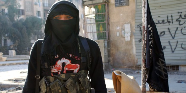 A member of jihadist group Al-Nusra Front stands in a street of the northern Syrian city of Aleppo on January 11, 2014. Fighting pitting the Islamic State of Iraq and the Levant (ISIL) against other rebel groups -- including Al-Nusra Front, which is also linked to Al-Qaeda but is seen as more moderate -- broke out in Syria last week. AFP PHOTO / BARAA AL-HALABI        (Photo credit should read BARAA AL-HALABI/AFP/Getty Images)