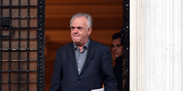 Greek Deputy Prime Minister Yiannis Dragasakis leaves the Prime Minister Alexis Tsipras' office in Athens at the end of the meeting between the Prime Minister and his top ministers on August 11, 2015. Greece on August 11 announced it had reached the outline of a deal for an international bailout worth 85 billion euros ($94 billion) that it hopes will save its economy from financial collapse. AFP PHOTO/ LOUISA GOULIAMAKI        (Photo credit should read LOUISA GOULIAMAKI/AFP/Getty Images)