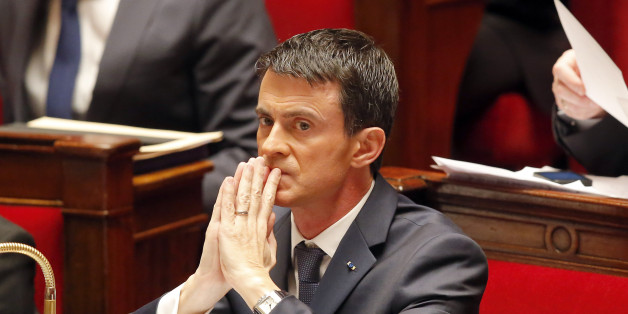 French Prime Minister Manuel Valls is concentrated after he addressed the parliament at the national assembly in Paris, Thursday Nov.19,2015. Valls is warning that the associates of extremists who targeted France last week could use chemical and biological weapons, as he urged Parliament to extend a state of emergency. (AP Photo/Michel Euler)