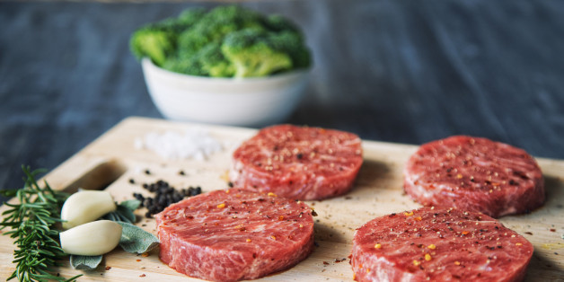 Premium raw Japanese beef steaks on cutting board with broccoli