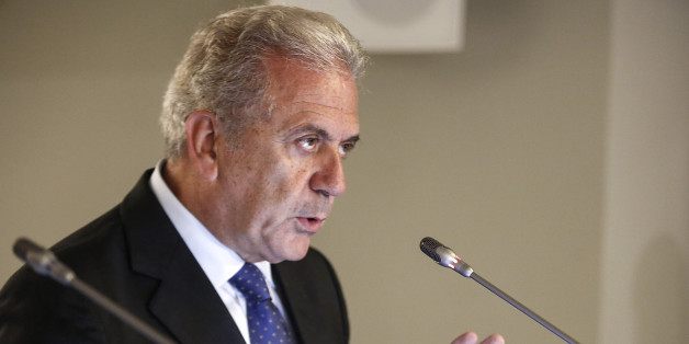 """European Commissioner for Migration and Home Affairs Dimitris Avramopoulos addresses journalists during a news conference in Athens, Greece, Saturday Oct. 10, 2015. Greece's first """"hotspot,"""" or migrant processing center, will open over the next 10 days, allowing migrants to be flown to other European Union countries, mostly of their preference, and have their asylum applications processed there, European Union officials say. (AP Photo/Yorgos Karahalis)"""