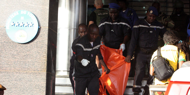 A body is removed from the  Radisson Blu hotel, after it was stormed by gunmen during a attack on the hotel in Bamako, Mali, Friday, Nov. 20, 2015. Islamic extremists armed with guns and grenades stormed the luxury Radisson Blu hotel in Mali's capital Friday morning, and security forces worked to free guests floor by floor.  (AP Photo/Harouna Traore)