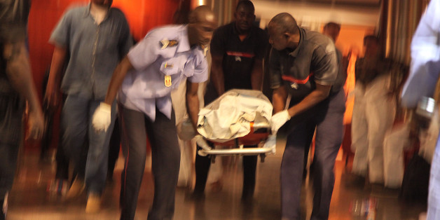 Mali security personal carry the body of a victim inside the Radisson Blu hotel after an attack by gunmen on the hotel in Bamako, Mali, Friday, Nov. 20, 2015. Islamic extremists armed with guns and grenades stormed the luxury Radisson Blu hotel in Mali's capital Friday morning, and security forces worked to free guests floor by floor.  (AP Photo/Baba Ahmed)